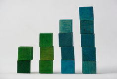 Coloured Cubes on White Background. Green and blue stacked coloured wooden cubes isolated on white background Stock Photo