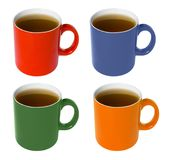 Coloured cup - with tea. Four colored (red, blue, green, yellow) cup - with tea Stock Images