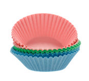 Coloured cupcake baking paper cases on white royalty free stock image