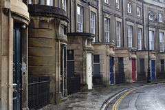 Coloured doors on Victorian street Stock Image