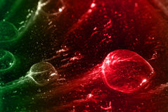 Coloured drops. In red and green stock photo
