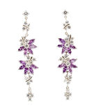 Coloured earrings on white Stock Photos