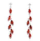 Coloured earrings on white Royalty Free Stock Image