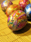 Coloured easter eggs. On yellow background royalty free stock images
