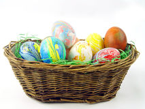 Coloured easter eggs in a basket Royalty Free Stock Photography