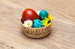 Coloured Easter eggs. In a basket Stock Image