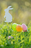 Coloured Easter Eggs In Basket Padded Out With Rabbit Decorations Royalty Free Stock Image