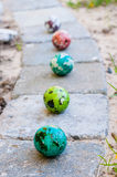 Coloured Easter eggs. On cobblestones Royalty Free Stock Image