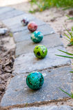 Coloured Easter eggs. On cobblestones Royalty Free Stock Photos