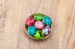 Coloured Easter eggs. On wood background Stock Photo