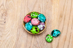 Coloured Easter eggs. On wood background Royalty Free Stock Image