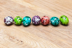 Coloured Easter eggs. On wood table Royalty Free Stock Photos