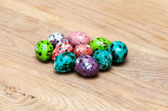Coloured Easter eggs. On wood table Stock Image