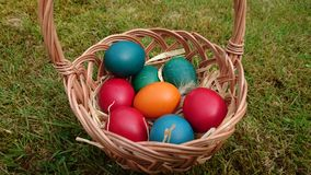 Coloured eggs in a basket Royalty Free Stock Photography