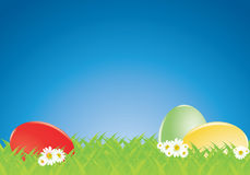 Coloured eggs in a meadow Stock Images