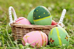 Coloured eggs on meadow c Royalty Free Stock Photography