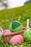 Coloured eggs on meadow a Stock Image