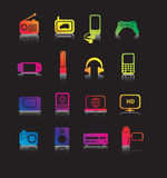 Coloured electronic icons. Set of coloured entertainment icons and symbols on black with reflection Royalty Free Stock Image