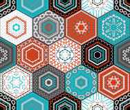 Coloured embroidered hexagons background. Royalty Free Stock Photography