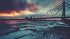 Coloured evening clouds float over half frozen Dnipro river stock video footage