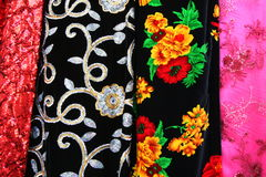Patterned and colourful fabric for sale. Some of the coloured fabrics for sale on a market stall in Istanbul, Turkey Stock Image