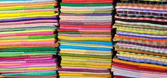 Coloured fabrics at market Royalty Free Stock Photos
