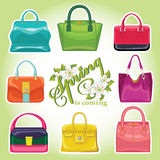 Coloured fashion womens handbags.Spring is comming Stock Photos
