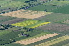 Coloured fields in the valley from above Royalty Free Stock Image