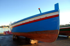 A coloured fishing boat. In the Porto Piccolo (small harbour) in Syracuse, Italy Stock Image