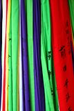Coloured flags. A group of coloured flags hanging from a shinto shrine in Japan Stock Photos