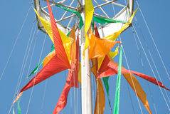 Coloured flags against blue sky. Coloured holiday triangle flags against blue sky stock images