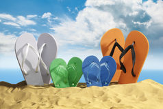 Coloured Flip Flops on Beach Stock Photo