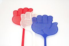 Coloured fly swatters Stock Photos