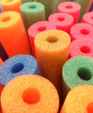 Coloured Foam Pool Noodles abstract background Stock Image