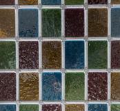 Coloured frosted glass. Small panes of frosted glass forming a regular grid pattern Royalty Free Stock Image