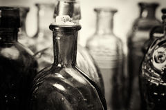 Free Coloured Glass Bottles On A Rustic Background Royalty Free Stock Photo - 90482075