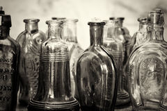 Coloured glass bottles on a rustic background Royalty Free Stock Image