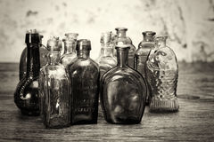 Coloured glass bottles on a rustic background Stock Photo
