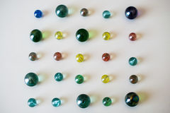 Coloured glass marbles, childhood game Stock Photos