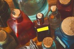 Coloured glass pharm bottles Stock Images