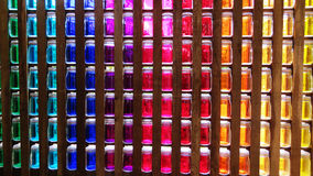 Coloured glass pots in a wall. Wall of coloured glass weck jars in a row Royalty Free Stock Photos