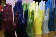 Coloured-gloves-02. Coloured glows in a shop window stock photos