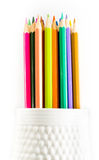 Coloured group of pencils in a cup  school supplies  on white ba Royalty Free Stock Photo