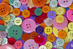 Coloured hole buttons Stock Images