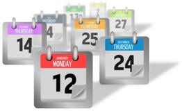 Coloured kalendarz wzywa pozycję biurko Fotografia Stock