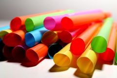 Coloured king size straws piled together. Coloured straws, gathered in one place to create a colourful photo stock photos