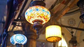 Coloured lamps interior. Coloured pendent lamps latern light stock video