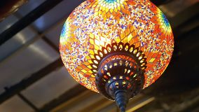 Coloured lamps interior. Coloured pendent lamps latern light stock footage