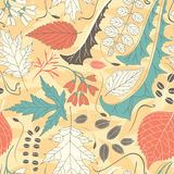 Coloured leaves on a yellow background Royalty Free Stock Photography