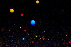 Coloured light bulbs Stock Images